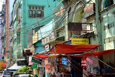 Yangon, Myanmar - March 9, 2015: A street archtecture view with colonial building in the town of Yangon. Yangon, Myanmar - March 9, 2015: A street archtecture Stock Images