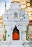 Buddhist monk at Shwedagon Pagoda, in Yangon, Myanmar royalty free stock photo