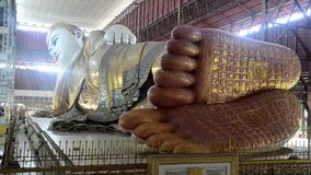 Yangon, Myanmar - November15, 2015: The Chaukhtatgyi Temple with worshipers at the giant reclining Buddha,the one of the biggest a stock video