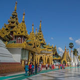 Yangon, Myanmar, November 10, 2014 - Inside Shwedagon. White pagoda on the background of blue sky, Yangon Myanmar Royalty Free Stock Photography