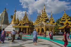 Yangon, Myanmar, November 10, 2014 - Inside Shwedagon. White pagoda on the background of blue sky, Yangon Myanmar Stock Photography