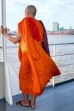 YANGON, MYANMAR - november 24, 2015: Monk on the ferry at Yangon Stock Photo