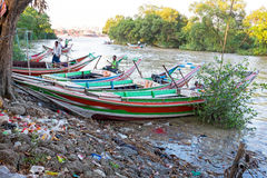 YANGON, MYANMAR - NOVEMBER 25 - Traditional fishing boats in the Royalty Free Stock Photos