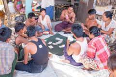 YANGON, MYANMAR - November 25, 2015: Villagers playing cards Royalty Free Stock Photos