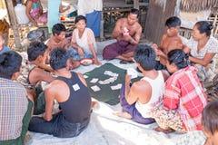 YANGON, MYANMAR - November 25, 2015: Villagers playing cards Royalty Free Stock Photos