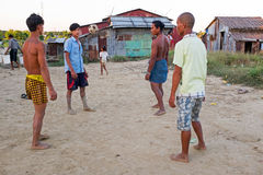 YANGON, MYANMAR - November 25, 2015: Young guys playing football Royalty Free Stock Image