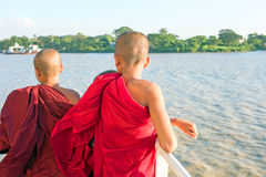 YANGON, MYANMAR - november 24, 2015: Young monks on the ferry Royalty Free Stock Image