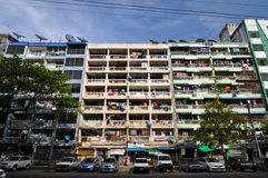 YANGON, MYANMAR - OCTOBER 12, 2013 - Facade of run-down housing Stock Photography