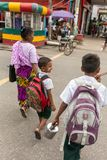 Unidentified burmese woman taking her kids to school. stock photos