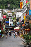 Yangshuo, China - circa July 2015: Streets of tourist town Yangshuo on the banks of Li river in  China. Yangshuo, China - circa July 2015: Streets of tourist Stock Photography