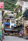 Yangshuo, China - circa July 2015: Streets of tourist town Yangshuo on the banks of Li river in  China. Yangshuo, China - circa July 2015: Streets of tourist Royalty Free Stock Images