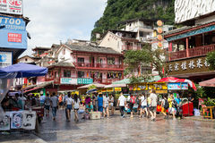 Yangshuo, China - circa July 2015: Streets of tourist town Yangshuo on the banks of Li river in  China. Yangshuo, China - circa July 2015: Streets of tourist Stock Images