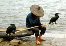 Yangshuo, China: Man with Comorrants Stock Photos