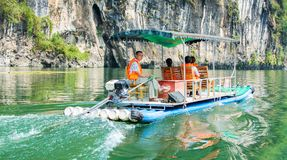 YANGSHUO, CHINA - SEPTEMBER 23, 2016: Tourist cruise boat on a L Stock Photography