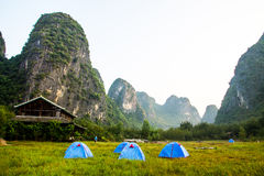 Yangshuo Cliffs. Amidst the tall limestone formations in Yangshuo, China is a large tourism business giving rides through the picturesque country-side Stock Photography
