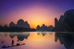 Yangshuo & Fisherman. Photo of the sunset at yangshuo with the fisherman Royalty Free Stock Photo