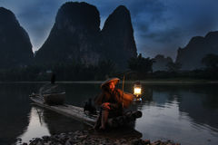 YANGSHUO - JUNE 18: Chinese man fishing with cormorants birds Stock Image