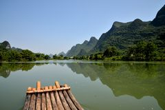 Yangshuo scenery. Colors hill nature reflection reflections rock scenery shadows stalactites stone water yangshuo Royalty Free Stock Photography