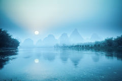 Yangshuo scenery in sunrise. Tranquil landscape in guilin,China Royalty Free Stock Images