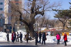 YANJIXI, JILIN, CHINA - March 9, 2018: Old people are dancing in the public place of the park square in the city center stock images
