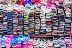 YANJIXI, JILIN, CHINA - March 9, 2018: Slippers are sold spread out and stacked stock photo