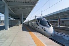 View of a CRH high-speed bullet train at the YANJIXI Railway Station, JILIN, CHINA. YANJIXI, JILIN, CHINA - March 8, 2018: View of a CRH high-speed bullet train stock image
