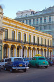 Yank Tanks in Havana Cuba with Yellow Building background Stock Photo