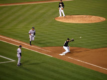 Yankee Alex Rodriguez runs to first base as Oakland A's first ba Stock Photo