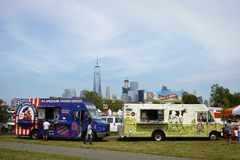Yankee Doodle Dandy's chicken tenders and Cheese curds trucks in park on independence day, WTC in background. July 4,2016, Liberty State Park, NJ, USA Stock Images
