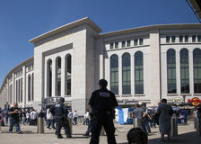 Yankee fans and police on opening day at the stadium in the Bron. BRONX, NEW YORK, USA - APRIL 10: NYPD and fans at Yankee Stadium for opeing game.  Taken April Royalty Free Stock Photo