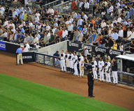 Yankees dunring god bless america song. A shot of Yankee players during God bless america song Royalty Free Stock Photos