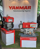 The YANMAR Compact tractor. SONGKHLA - August 11 : The YANMAR Compact tractor engine on display at The 21st Agricultural fair on August 11, 2013 in Songkhla royalty free stock photography