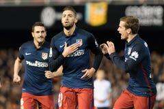 Yannick Carrasco. Antoine Griezmann and Koke Resurreccion of Atletico Madrid  celebrates the third goal during the La Liga match at Mestalla, Valencia Stock Image