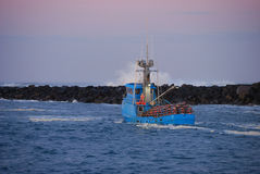 Yaquina Bay. Crabbing boat heading out to sea from the Yaquina Bay to the Pacific Ocean at Newport Oregon Stock Photo