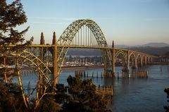 Oregon Coastal 101 Bridge Newport. This bridge softly alight with the setting sun is a Newport landmark. Opened in 1936 on route 101 coast highway in Oregon this Stock Images