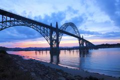 Yaquina Bay. Historic bridge at Newport, OR is silhouetted against a dramatic sunrise Stock Photography