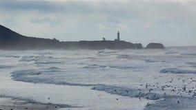Yaquina Head Lighthouse. Waves crashing ashore during January windstorm on the Pacific Northwest coast Stock Photography