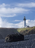Yaquina lighthouse from the beach. Royalty Free Stock Image