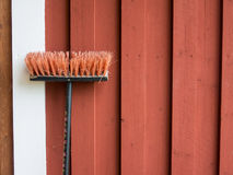 Yard brush near the wall of wooden rural house in Sweden Royalty Free Stock Photography