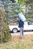 Yard clean up carrying trash can Stock Photography