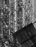Yard with a crowd of scaffolds, black and white. View of a restoration yard with a crowd of scaffolds in palermo, sicily, portrait cut Royalty Free Stock Photography