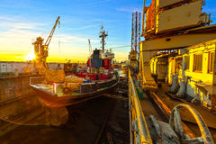 Yard at dawn. Ship in dry dock at sunrise - shipyards in Gdansk, Poland stock image