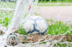 Yard football ball. Goal, gate. Old condition Stock Image