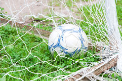 Yard football ball. Goal, gate. Old condition Royalty Free Stock Image