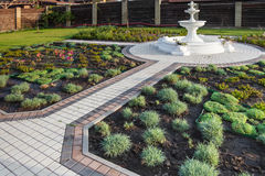 Yard with fountain and fresh planted plants Stock Photos