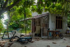 Yard with house, bicycle, table and chairs at the tropical island Stock Photography
