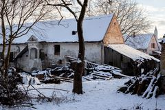 Old typical rural house in winter, abandoned before renovating royalty free stock images