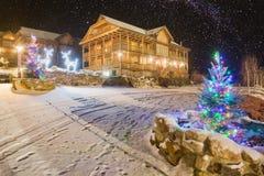 Yard illuminated by christmas lights. Ukrainian carpathian village covered with snow. Yard illuminated by christmas lights. Many stars in a night sky royalty free stock photos