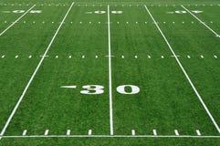 Yard-Line 30 auf amerikanischem Fußballplatz Stockfotografie