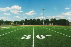 30 Yard Line on American Football Field and blue sky stock images